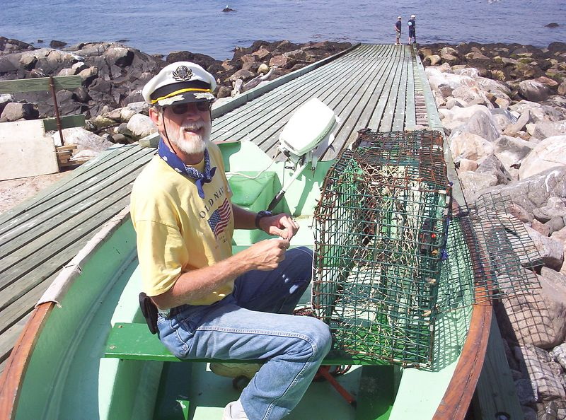 Captain John repairing one of the lobster pots.