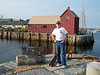 Captain John in front of Motif One in Rockport Harbor.
