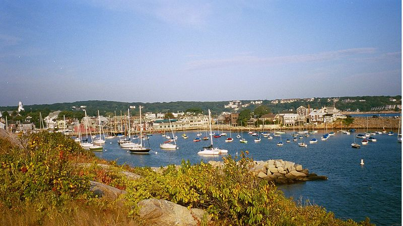Rockport, Massachusetts harbor.  Darlene and I got to Rockport early Saturday morning and ate breakfast at a local restaurant and then took a walk.  As we walked past houses lining the street we eventually followed a trail over a rise and came to the sea.  Darlene looked back towards the harbor and took this picture.  It shows the various boats at anchor and the rocky coastline.  Quite a nice picture.