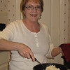 Linda cooking a small pot of rice