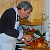 Terry carving the turkey.