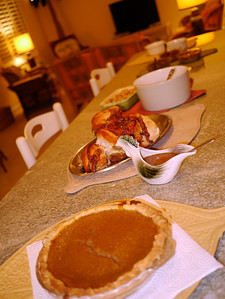 From front to back:  Pumpkin pie, Turducken with pan gravy, Sweet potatos and apples, Creamed onions, Mashed Rutabagas...