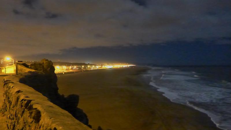 Ocean Beach at night .