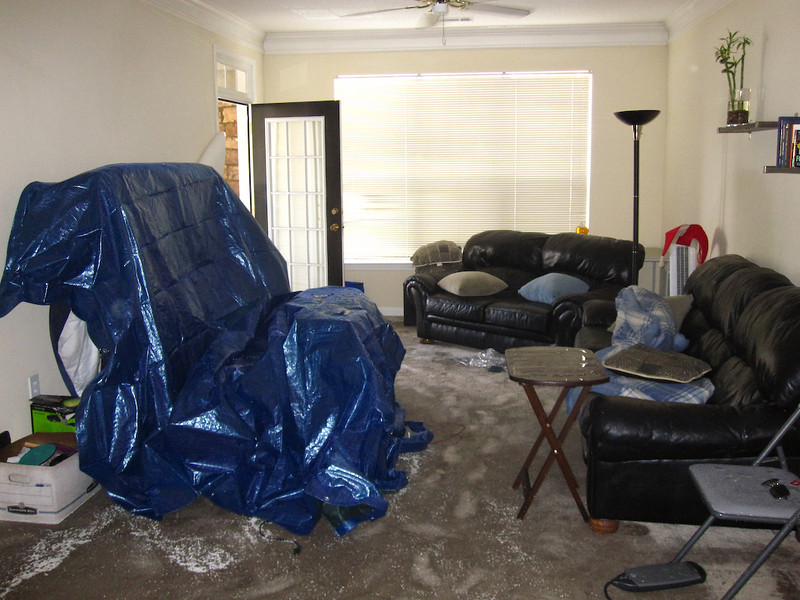 very wet living room.  the firefighters brought a tarp and put it over the tv.