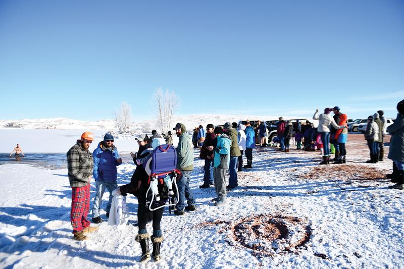 Matthew Gaston | The Sheridan Press<br>A large crowd gathered on the shore of Lake DeSmet to watch brave souls take the Polar Bear Plunge Tuesday, Jan. 1, 2019.