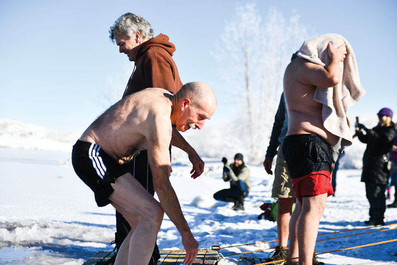 Matthew Gaston | The Sheridan Press<br>Harvey Purcella climbs out of Lake DeSmet after taking the Polar Bear Plunge for the 17th consecutive year Tuesday, Jan. 1, 2018.