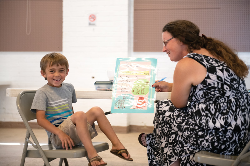 Matthew Gaston | The Sheridan Press<br>Mason Swinyer, 5, laughs during his interview with Kandra Ankney for the Clover Buds division Tuesday, July 30, 2019.