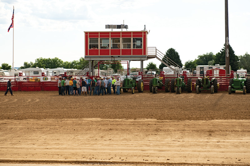 Matthew Gaston | The Sheridan Press<br>Contestants in the tractor pull gather in the arena to receive their instructions at the Sheridan County Fairgrounds Saturday, Aug. 3, 2019.