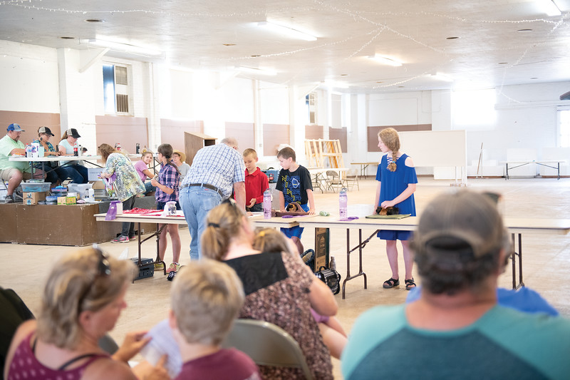 Matthew Gaston | The Sheridan Press<br>Judge Ward Cotton makes his way down the table judging the Pocket Pet Show in the Exhibit Hall at the Sheridan County Fairgrounds Tuesday, July 30, 2019.