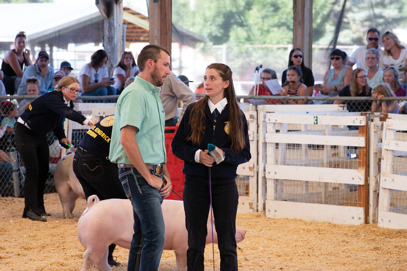 Matthew Gaston | The Sheridan Press<br>Judge Seth Keas, left, questions competitor Taziree Smith during the FFA Swine Showmanship event at the Sheridan County Fair Thursday, Aug. 1, 2019.