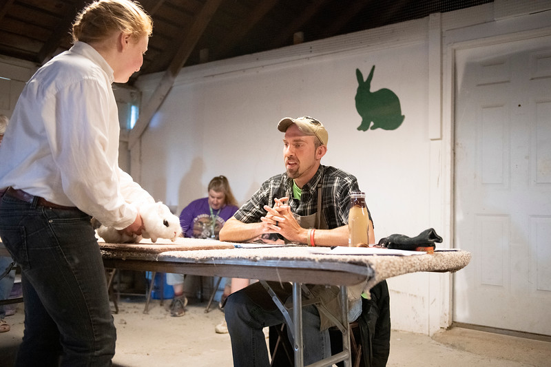 Matthew Gaston | The Sheridan Press<br>Shaun Smith, right, begins the judging process with Keira Benedict at the Rabbit Show During the Sheridan County Fair Friday, Aug. 2, 2019.