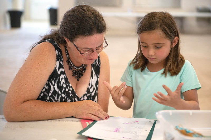 Matthew Gaston | The Sheridan Press<br>Katherine Swinyer, 7, explains how she made her animal paw prints to Kandra Ankney during her Clover Buds interview Tuesday, July 30, 2019.