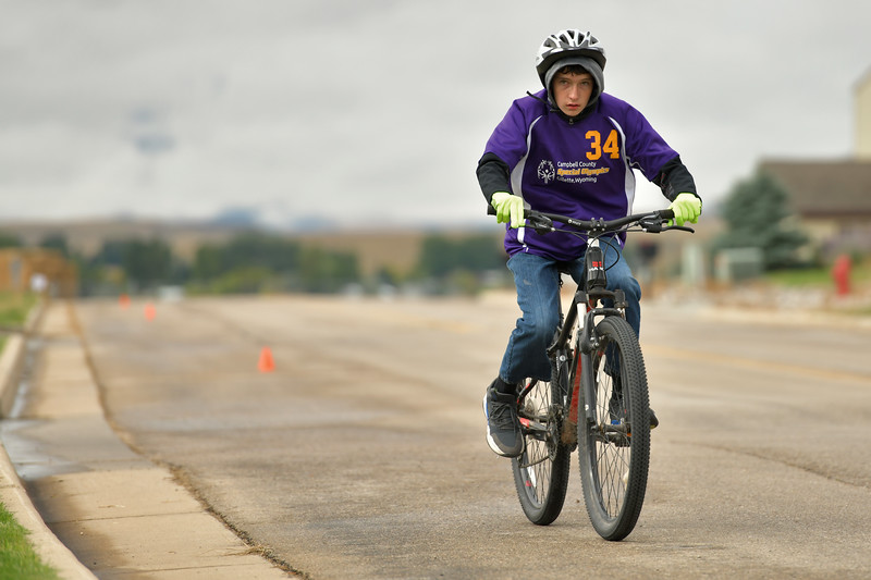 Matthew Gaston | The Sheridan Press<br>A.J. Nelson races by on his Haro bicycle during the 2K cycling race during the 2019 Special Olympics Area IV Fall Games Friday, Sept. 27, 2019.
