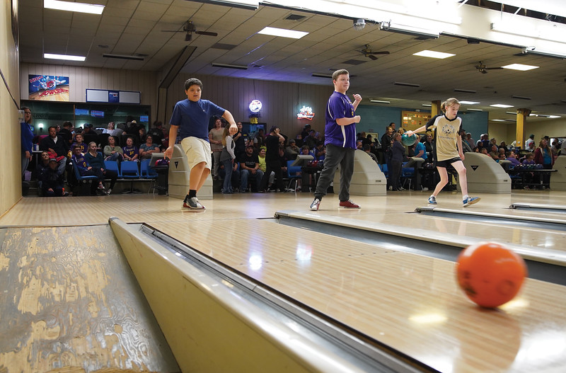 Matthew Gaston | The Sheridan Press<br>Nine-year-old Ryan Shippy, left, rolls a strike at Cloud Peak Lanes during the 2019 Special Olympics Area IV Fall Games Friday, Sept. 27, 2019.