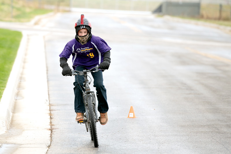 Matthew Gaston | The Sheridan Press<br>Chadlin Stephens speeds around the turn on his sixth of twelve laps during the 10K cycling race for the 2019 Special Olympics Area IV Fall Games Friday, Sept. 27, 2019.