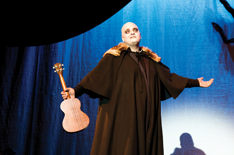"Matthew Gaston | The Sheridan Press<br>Cody Heaps demonstrates is chops on the stage and the ukulele as Uncle Fester in ""The Addams Family"" Thursday, Oct. 18, 2018."