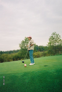 No this is not a funky perspective photo.  Check out the size of Mom's driver.  I believe the USGA would deem that club illegal, but thankfully Charity Best Ball Events don't care too much...