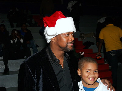 Chris Tucker, Comedian, Actor & Philanthropist poses with kids.