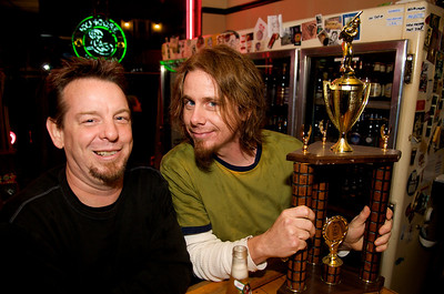 Kevin Worthington from Downtown, Cincinnati and Mark Flanigan of Northside showing of their trophy from the 2008 Richardson Beer League Softball Torunament