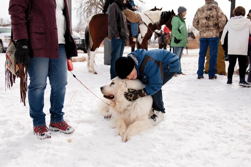 Matthew Gaston | The Sheridan Press<br>A boy hugs a fluffy dog during the Sheridan WYO Winter Rodeo Saturday, Feb. 23, 2019.
