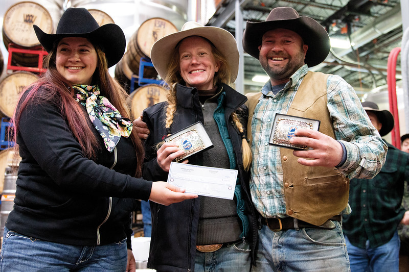 Matthew Gaston | The Sheridan Press<br>Bailey McLean, left, presents rider Melissa Ostrander and snowboarder Cal Douglas with the awards for first place in the snowboard class at the first-ever Sheridan WYO Winter Rodeo Saturday, Feb. 23, 2019.