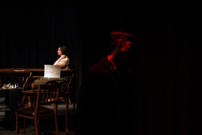 "Matthew Gaston | The Sheridan Press<br>The lights fade on Tom Wingfield, played by Marcel Bohlmann, as they begin to illuminate the memory of his sister Laura, played by Nicolette Krumberger, during the dress rehearsal for ""The Glass Menagerie"" Tuesday, Feb. 11, 2020."