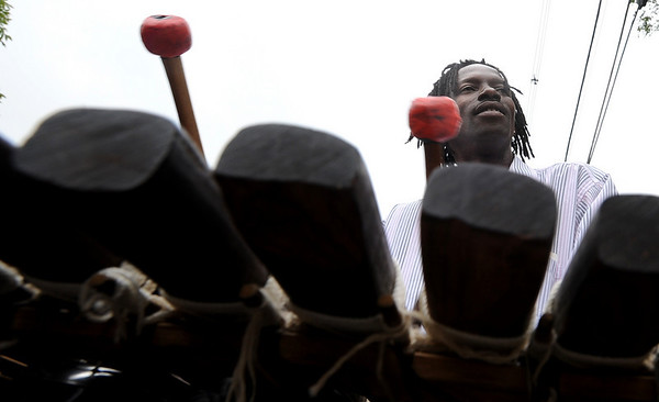 Facinet Bangoura of Guinea, West Africa, plays the balafon at The Hill Flea on Sunday.<br /> The Hill Flea goes every Sunday from 10 a.m. to 5 p.m. on Pennsylvania Ave and has food, live music, interactive workshops and crafts booths.<br /> Cliff Grassmick / August 30, 2009