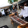 Facinet Bangoura, right,  of Guinea, West Africa, plays the balafon at The Hill Flea on Sunday.<br /> The Hill Flea goes every Sunday from 10 a.m. to 5 p.m. on Pennsylvania Ave and has food, live music, interactive workshops and crafts booths.<br /> Cliff Grassmick / August 30, 2009