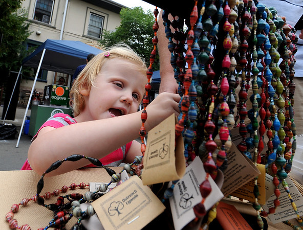 Caroline Warren, 3, checks out the necklaces at The  Hill Flea on Sunday.<br /> The Hill Flea goes every Sunday from 10 a.m. to 5 p.m. on Pennsylvania Ave and has food, live music, interactive workshops and crafts booths.<br /> Cliff Grassmick / August 30, 2009