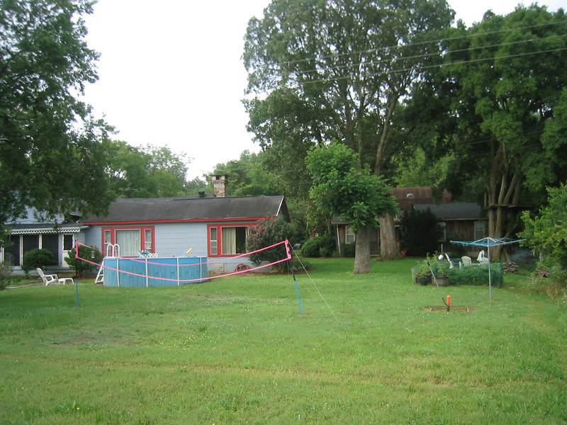 The changes look great,but the old yard was fun, summer 2004,Yes this is the same yard and house.The big oak tree is still there,the walnut tree trunk too.Evan's tree house still remains.