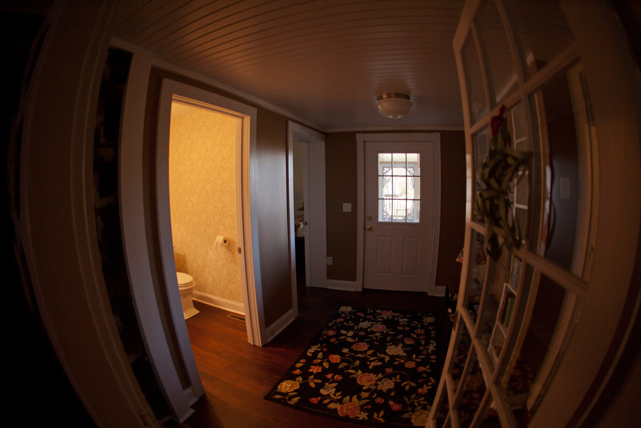 The new guest bath room redone hall with the entrance to the porch and the door to the master bedroom