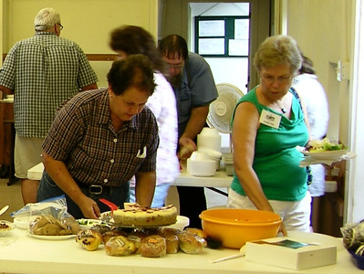 Attendees look over the desserts at the annual MABA picnic at Joanna Furnace, Aug. 20, 2013.