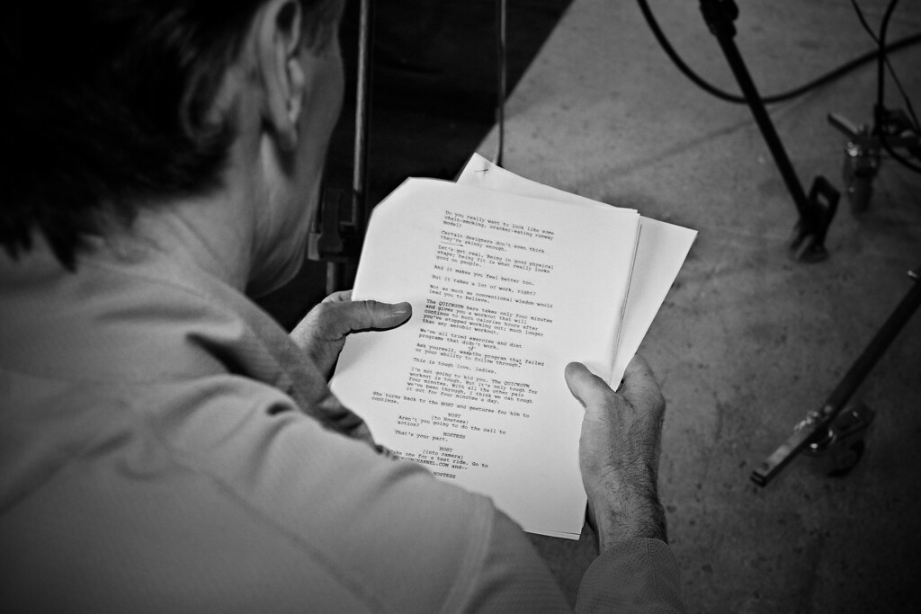 Ken is back to the director role and looks over the script.