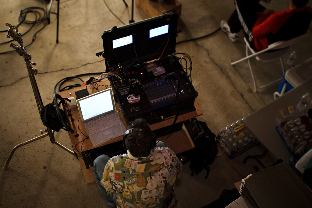 Joe (audio engineer) monitors the sound recording.