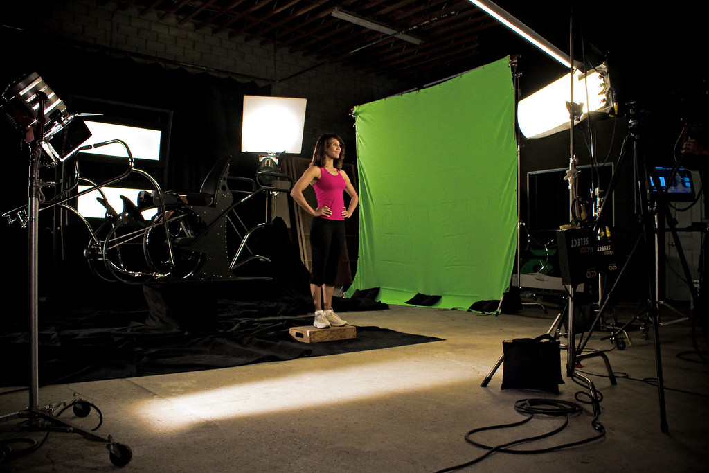 Evelyn prepares for the next scene. She is standing on a 1/4 apple box to be at the proper height for the camera angle.