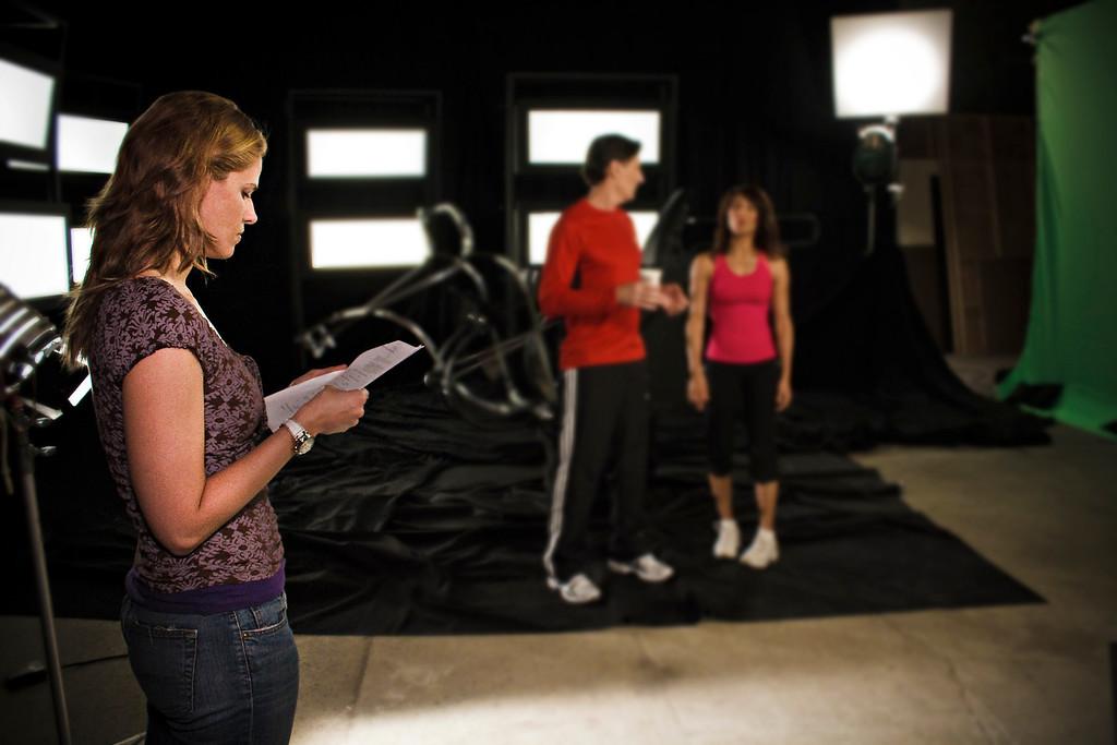 Xan follows along as Ken and Evelyn read more lines.