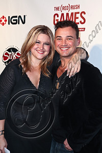 HOLLYWOOD, CA - JUNE 07:  Publicist Becky Poliakoff (L) and actor Vincent Flood arrive at the (RED)RUSH Games party at Avalon on June 7, 2012 in Hollywood, California.  (Photo by Chelsea Lauren/WireImage)