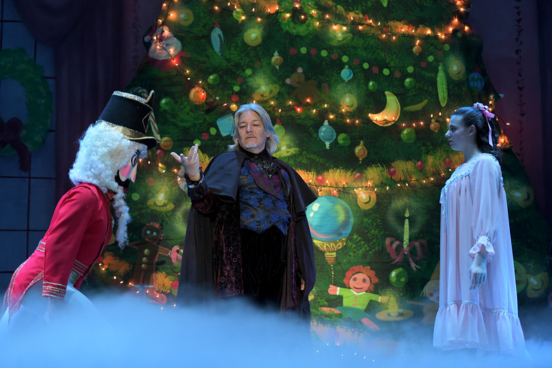 """Matthew Gaston   The Sheridan Press<br>Drosselmeyer, played by Javier Velasco, presents the nutcracker to his goddaughter Clara, played by Abigail Coonis, during the dress rehearsal for """"The Nutcracker"""" Wednesday, Dec. 4, 2019."""
