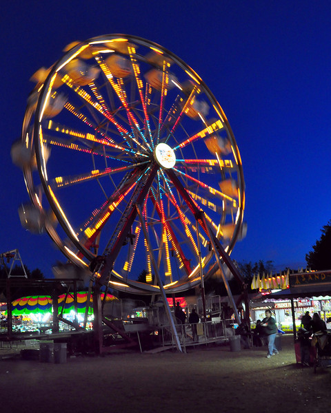 The ferris wheel spins into the night on opening day of the 99th Sandwich Fair, in Sandwich, NH. The fair ran from October 10th thru 12th, 2009