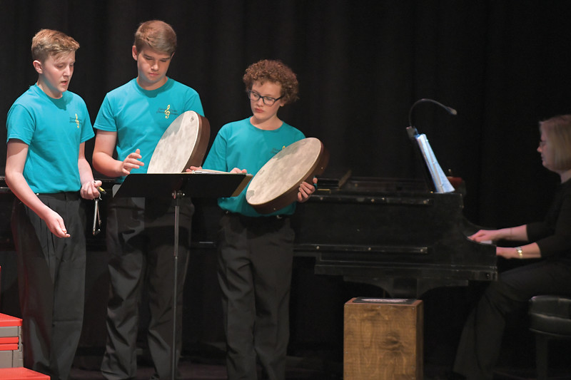Matthew Gaston | The Sheridan Press<br>From left, Phoenix Goode, Will Brooks and Camden Gonda do a little percussion work during rehearsal for the Sheridan County Children's Chorale recital Wednesday, May 15, 2019.