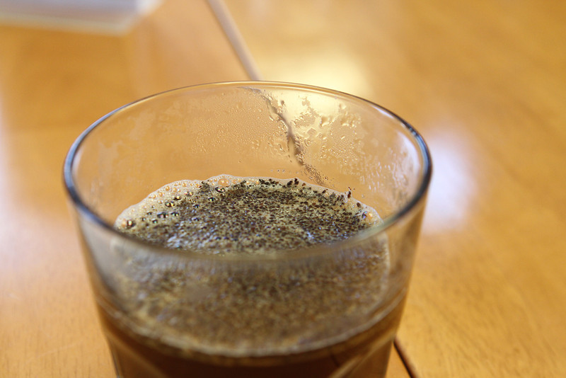 The coffee sits and steeps for several minutes, developing a warm even crust.
