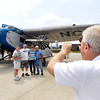 John P. Cleary | The Herald Bulletin<br /> Historic 1929 Ford Tri-Motor airplane flies into Anderson Municipal Airport. Anderson Mayor Kevin Smith takes a group photo.