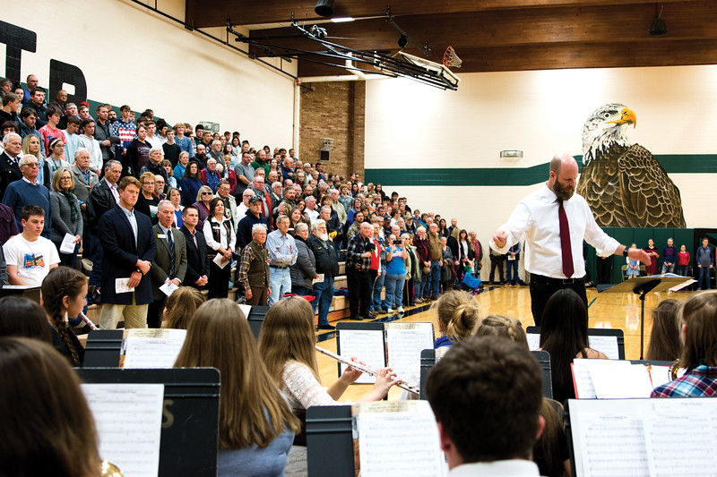 "Matthew Gaston | The Sheridan Press<br>The crowd rises to their feet as the band, led by Jason McArthur plays ""After the Battle,"" during the Veterans Day Assembly at Tongue River Middle School Thursday, Nov. 8, 2018."