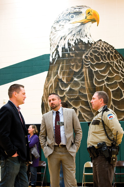 Matthew Gaston | The Sheridan Press<br>State Senator Bo Biteman, left, talks with Sheridan County School District 1 Business Manager Jermey Smith, center and Deputy Boot Hill, right, prior to the Veterans Day Assembly at Tongue River Middle School Thursday, Nov. 8, 2018.