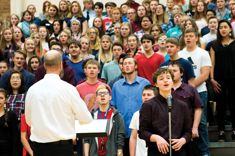 """Matthew Gaston   The Sheridan Press<br>Tongue River High School junior Kal Aksamit was one of two soloists to sing during the choir's performance of """"God Bless the U.S.A."""" at the Veterans Day Assembly Thursday, Nov. 8, 2018."""