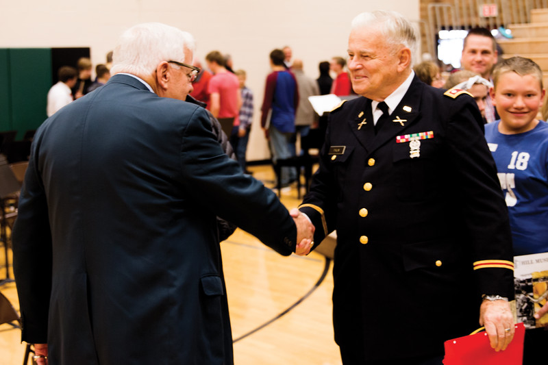 Matthew Gaston | The Sheridan Press<br>U.S. Senator Mike Enzi, left, shakes hands with Lt. Col. Sig Palm at the conclusion of Tongue River Middle School's Veterans Day Assembly Thursday, Nov. 8, 2018.