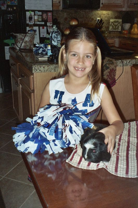 Delaney with her Guiney Pig...Peppy Le Pew.