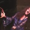 Janice Joplin with tambourine and microphone