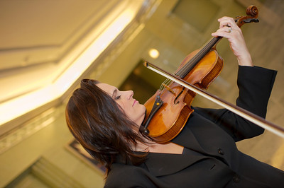 The velvety sounds of First Violinist De Ann Letourneau Concertmaster for the Las Vegas Philharmonic in this photograph. De Ann is alot of fun to work with! Thank you De Ann.