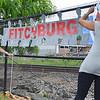 """Volunteers Anne Mola and Evelina Paulino work on the unify Fitchburg art puzzle project at the """"Juneneenth Celebration"""" at Riverfront Park in Fitchburg on Saturday afternoon. SENTINEL & ENTERPRISE / Ashley Green"""